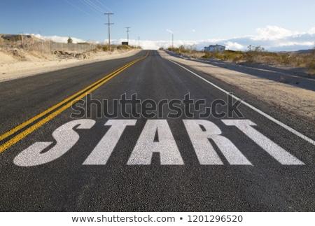 close up of word begin on suburban asphalt road Stock photo © dolgachov