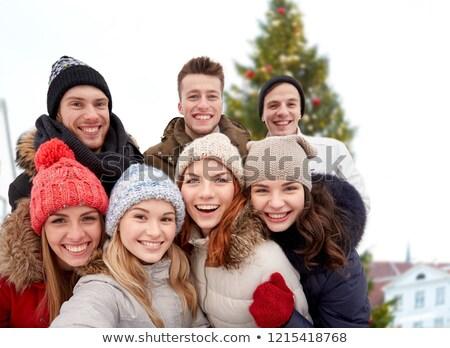 Boldog barátok karácsonyfa öreg Tallinn ünnepek Stock fotó © dolgachov