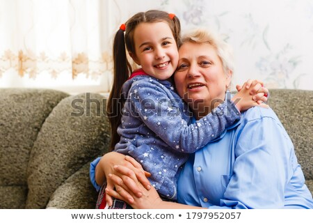 A grandmother with cute grandchild girl on light background Stock photo © Lopolo