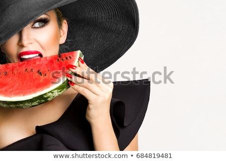 Gyönyörű szőke nő lány piros ajkak körmök eszik Stock fotó © serdechny