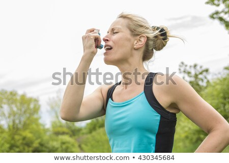 woman who have a asthme crisis outside Stock photo © Lopolo