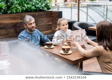 Család három ül kávézó cappucchino megbeszél Stock fotó © pressmaster