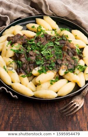 Freshly cooked, Polish traditional potato dumplings serving with Stock photo © joannawnuk