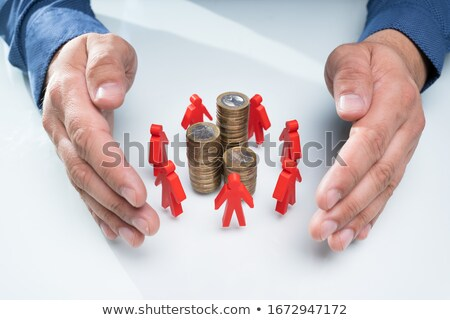 Protecting Red Human Figures Surrounding Stacked Coins Stock photo © AndreyPopov