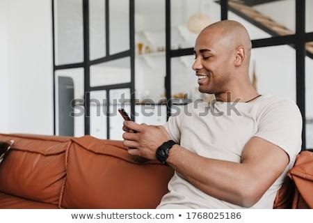 Görüntü iyimser neşeli adam oturma Stok fotoğraf © deandrobot