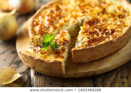Homemade cheese quiche with onion and bacon Stock photo © Peteer