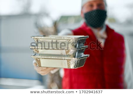 Courier hold go box food, delivery service, Takeaway restaurants food delivery to home door. Stock photo © Illia