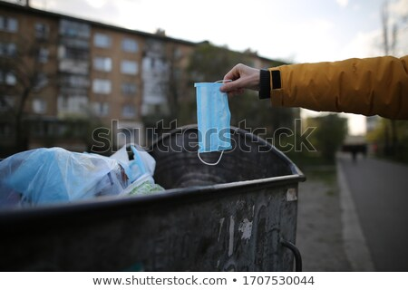 man throwing a surgical mask to the trash can Stock photo © nito