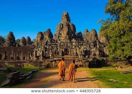 Gezichten tempel angkor Cambodja oude steen Stockfoto © dmitry_rukhlenko