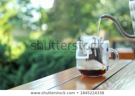 Outdoor coffee table on wooden ground Stock photo © Ansonstock