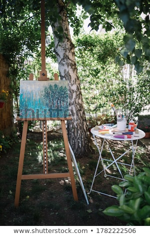 Easel and paintbrush Stock photo © Filata