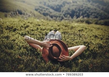Beautiful woman laying on the grass Stock photo © konradbak
