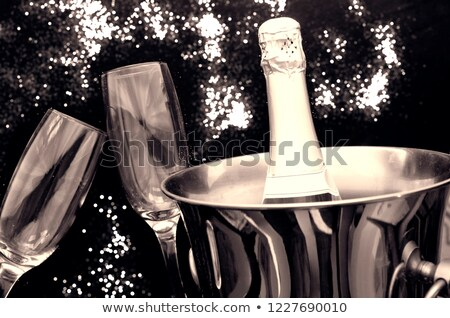 glasses of champagne with silver ice bucket and fireworks stock photo © sandralise