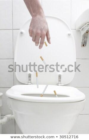 Flushing cigarettes Stock photo © leeser