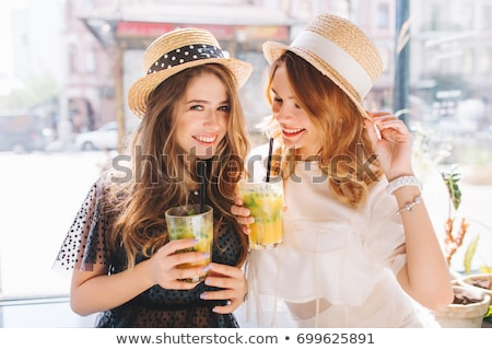 Smiling young woman wearing a straw hat and having fun at the be Stock photo © HASLOO