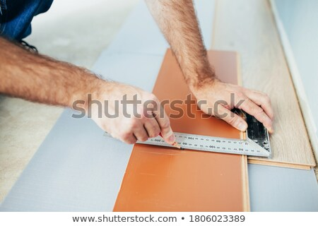 Man marking a floorboard with a pencil Stock photo © photography33