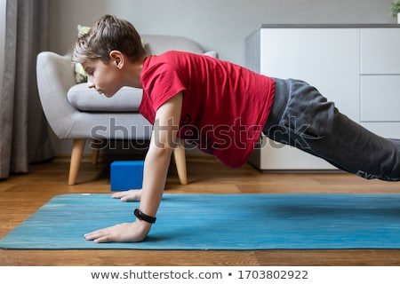 Fitness and Exercise - boy exercising stock photo © lovleah