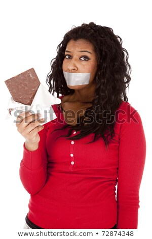 serious woman eating chocolate bar Stock photo © feedough