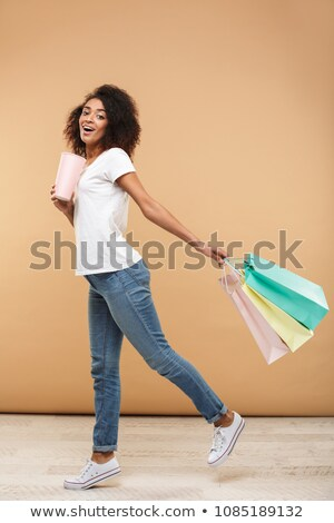 American beauty holding shopping bags, walking pose Stock photo © stockyimages