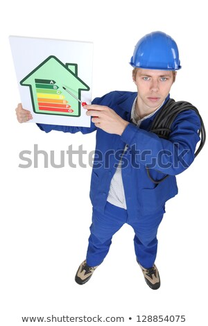 electrician showing the level of energy consumption of a house Stock photo © photography33