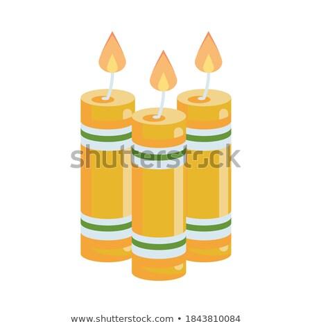 yellow candle stock photo © oblachko