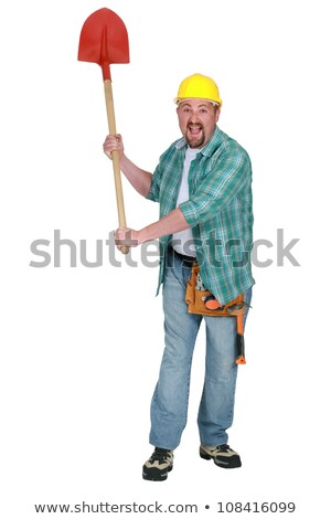 A delirious tradesman holding up a spade Stock photo © photography33