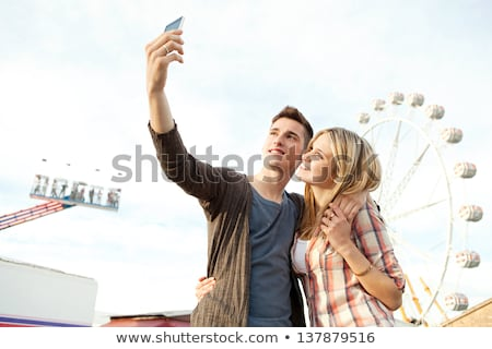 couple taking picture of themselves with cell phone stock photo © photography33