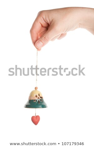 Hand holding little ceramics bell Stock photo © Taigi