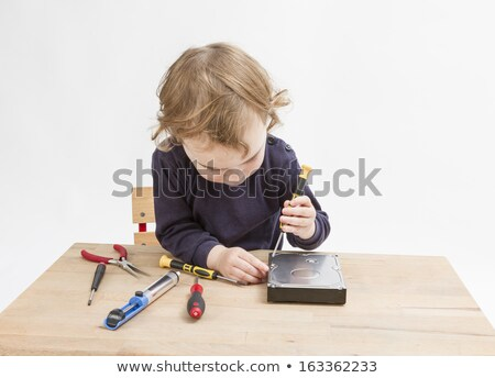 young child working at open hard drive Stock photo © gewoldi