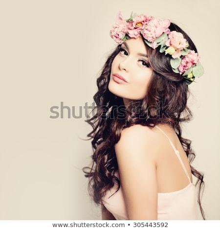 portrait of brunette girl with flowers  Stock photo © OleksandrO