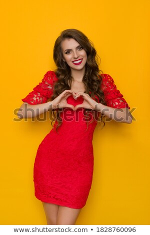 Stylish ecstatic young female in long red fashion dress posing stock photo © gromovataya