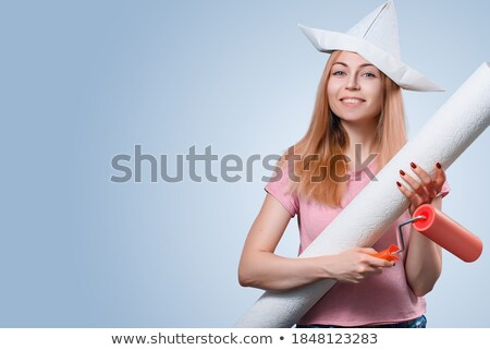 woman preparing to wallpaper a room stock photo © photography33