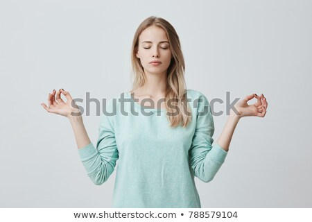 portrait of a blonde girl with closed eyes Stock photo © carlodapino