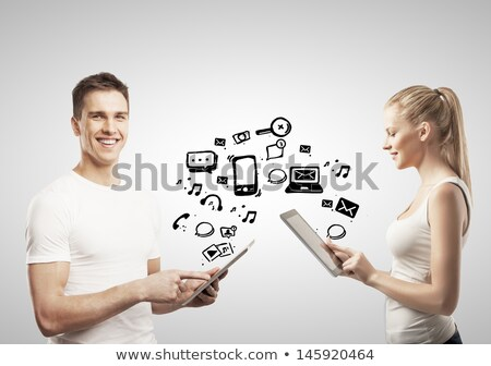 young woman looking at modern tablet with social icons stock photo © ra2studio