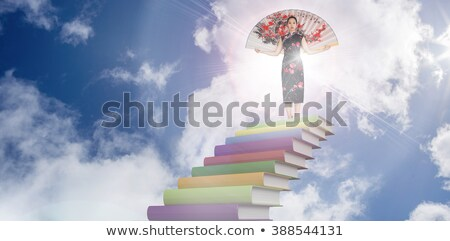 woman wearing traditional silk kimono with large silk fan stock photo © wavebreak_media