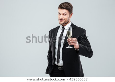 Confident businessman holding glass of champagne stock photo © photography33