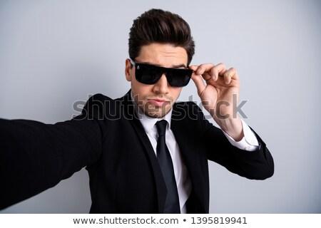 Przystojny młodych biznesmen odizolowany biały działalności Zdjęcia stock © Len44ik