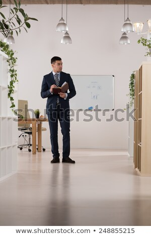Full length portrait of thoughtful business man with diary Stock photo © Discovod