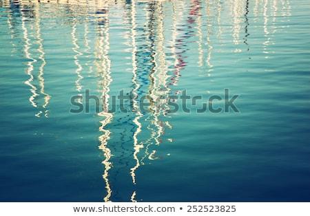 blue marina sunset boats with water reflection stock photo © lunamarina