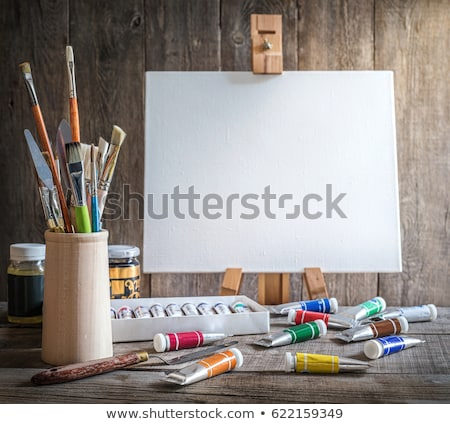studio painter with easel and canvas, old wood Stock photo © stokkete