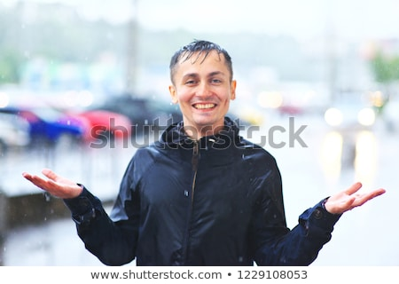 Man under very heavy rain Stock photo © carbouval