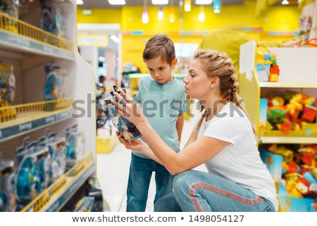 mother and son shopping for toys stock photo © d13
