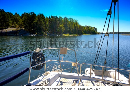 blue water reflection of sailboats boats poles in waves stock photo © lunamarina