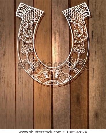 horseshoe with floral ornament Stock photo © Elmiko