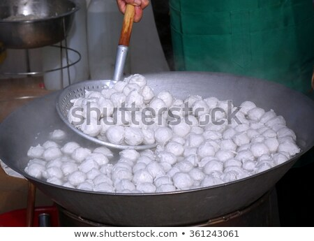 Chinese Food:Boiled dumplings in a pot Stock photo © bbbar