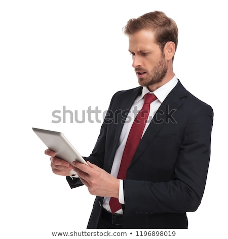 business man looks at his tablet with awe Stock photo © feedough