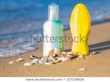Nap elleni védelem homokos tengerpart tenger víz test szépség Stock fotó © Len44ik