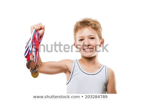 Smiling athlete champion child boy gesturing for victory triumph Stock photo © ia_64
