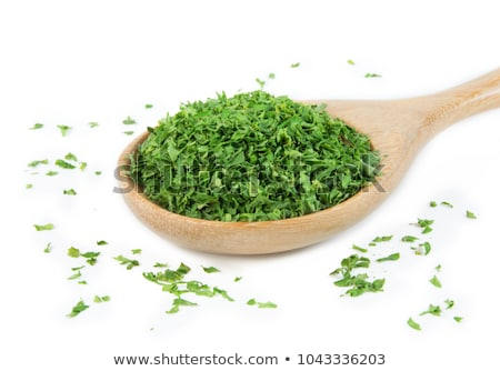 chopped parsley on wooden spoon stock photo © stevanovicigor