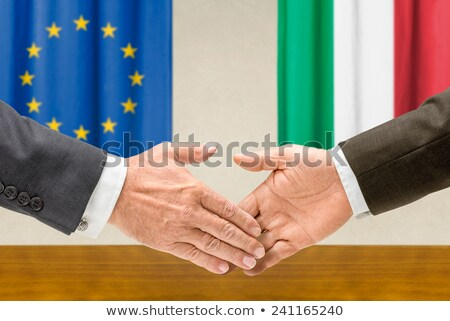 Representatives of the EU and Italy shake hands Stock photo © Zerbor